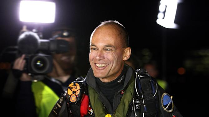 Bertrand Piccard, pilot of the Solar Impulse plane, speaks to reporters before taking off on a multi-city trip across the United States from Moffett Field NASA Ames Research Center in Mountain View, Calif., Friday, May 3, 2013. Solar Impulse, considered the world's most advanced solar-powered plane, will stop for seven to 10 days at major airports in each city, so the pilots can display and discuss the aircraft with reporters, students, engineers and aviation fans. It plans to reach New York's Kennedy Airport in early July — without using a drop of fuel, its creators said. (AP Photo/Tony Avelar)