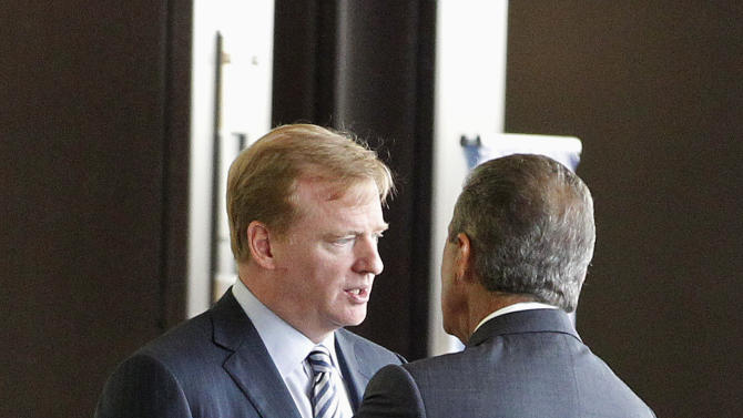NFL commissioner Roger Goodell, left, speaks with Atlanta Falcons owner Arthur Blank during an NFL owners labor committee meeting in College Park, Ga., on Thursday, July 21, 2011. (AP Photo/John Bazemore)