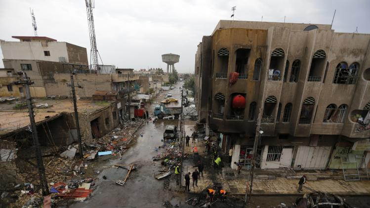 A general view of the site of a car bomb attack in the neighbourhood of al-Qahera is seen in northern Baghdad
