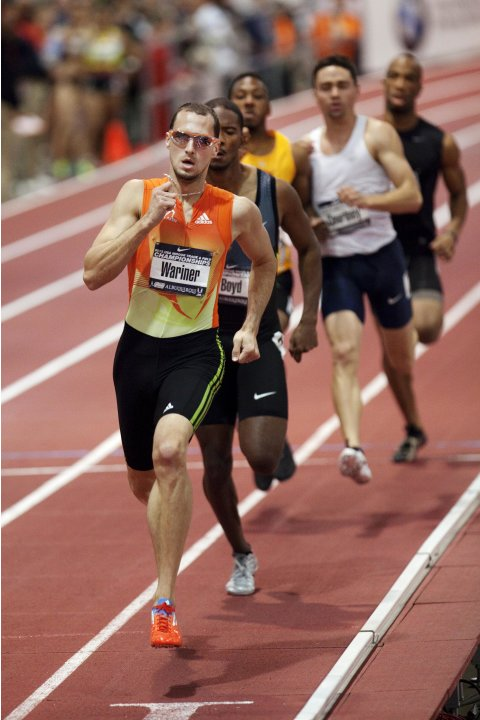 Wariner takes the lead before winning the finals of the men's 400 meter dash at the USA Indoor Track and Field Championships in Albuquerque