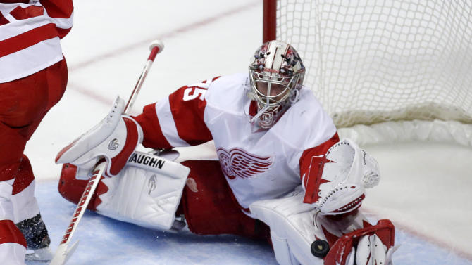 Detroit Red Wings goalie Jimmy Howard stops a shot during the first period in Game 7 of their first-round NHL hockey Stanley Cup playoff series against the Anaheim Ducks in Anaheim, Calif., Sunday, May 12, 2013. (AP Photo/Chris Carlson)