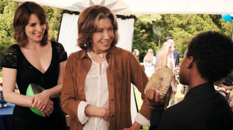 "This publicity photo released by Focus Features shows, from left, Tina Fey, as Portia, Lily Tomlin, as Susannah and Travaris Spears as Nelson in a scene from the comedy/drama film, ""Admission,"" directed by Paul Weitz. The movie is a Focus Features release opening March 22. (AP Photo/Focus Features)"