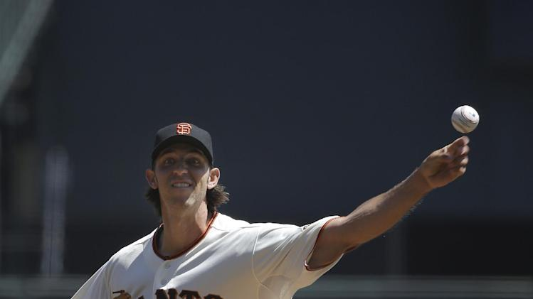 San Francisco Giants pitcher Madison Bumgarner throws against the Los Angeles Dodgers during the first inning of a baseball game in San Francisco, Thursday, April 17, 2014