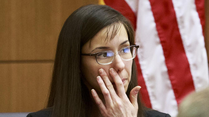 Defendant Jodi Arias pauses as she testifies in her murder trial in Judge Sherry Stephens' Superior Court, on Wednesday, Feb. 6, 2013.  Arias, 32, is accused of stabbing and slashing Travis Alexander, 27 times, slitting his throat and shooting him in the head in his suburban Phoenix home in June 2008. She initially denied any involvement, then later blamed it on masked intruders before eventually settling on self-defense.  (AP Photo/The Arizona Republic, Charlie Leight)