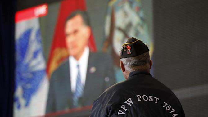 Vietnam veteran David Snyder of Metamora, Ohio, watches a live video broadcast of Republican presidential candidate, former Massachusetts Gov. Mitt Romney, at a campaign event with Republican vice presidential candidate, Rep. Paul Ryan, R-Wis., Monday, Oct. 8, 2012, in Swanton, Ohio.  (AP Photo/Mary Altaffer)