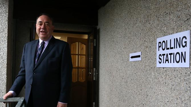 Scotland's First Minister Alex Salmond poses for photographs after casting his ballot at Ritchie Hall in Strichen, Scotland, Thursday, Sept. 18, 2014. Polls opened across Scotland in a referendum that will decide whether the country leaves its 307-year-old union with England and becomes an independent state. (AP Photo/Scott Heppell)