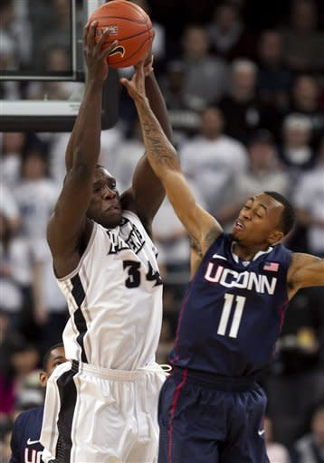 Cotton helps Providence take down UConn 72-70