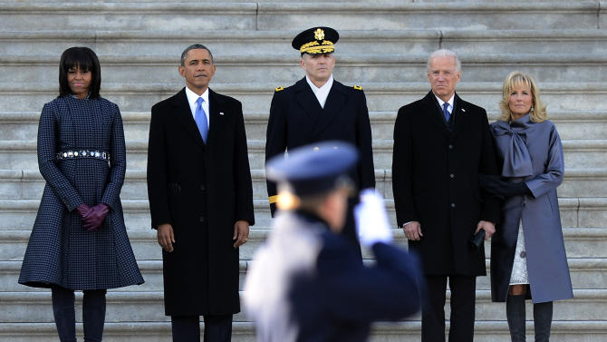 President Barack Obama, second from left, accompanied by, from left, first lady Michelle Obama, Army Maj. Gen. Michael J. Linnington, Vice President Joe Biden and Dr. Jill Biden watch during the Presidential review of the troops on the east side of the Capitol in Washington, Monday, Jan. 21, 2103, following the president's swearing-in ceremony at the 57th Presidential Inauguration. (AP Photo/CJ Gunther, Pool)