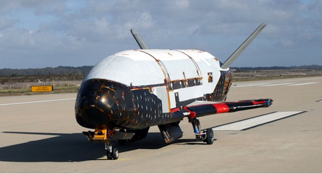 FILE - This undated file image provided by the U.S. Air Force shows the X-37B spacecraft. The unmanned Air Force space plane steered itself to a landing early Saturday, June 16, 2012, at a California