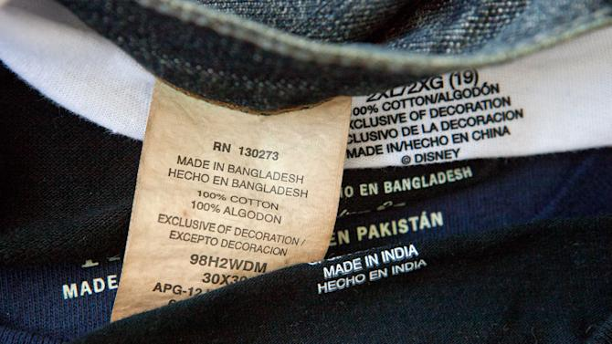 This photo illustration made Thursday, Dec. 13, 2012, shows labels of garments made in Bangladesh, India, China, and Pakistan, that were bought at a Wal-Mart store in Atlanta. Global clothing brands involved in Bangladesh's troubled garment industry responded in starkly different ways to the building collapse that killed more than 600 people. Some quickly acknowledged their links to the tragedy and promised compensation. Others denied they authorized work at factories in the building even when their labels were found in the rubble. (AP Photo/David Goldman)