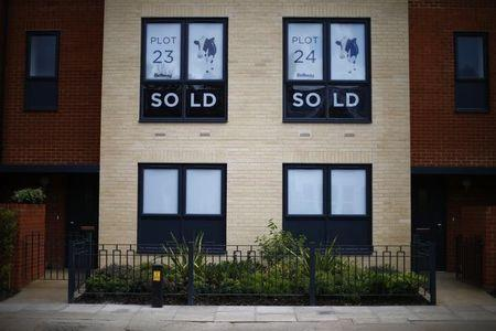 Sold new build homes are seen on a development in south London