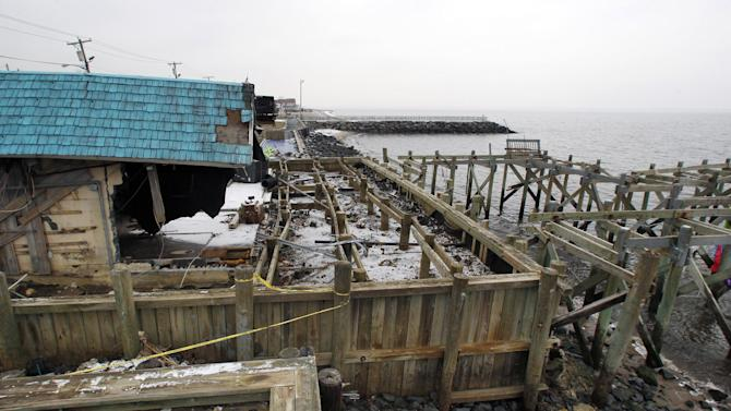 """Heavily damaged by Superstrom Sandy, Jakeabob's Bay restaurant and piers are seen Tuesday, Feb. 5, 2013, in Union Beach, N.J. New Jersey Gov. Christie told a gathering in Union Beach Tuesday that the National Flood Insurance Program's handling of claims in New Jersey """"has stunk,"""" complaining that the program has been far too slow to resolve claims from Superstorm Sandy, with 70 percent of cases unresolved three months after the disaster. (AP Photo/Mel Evans)"""