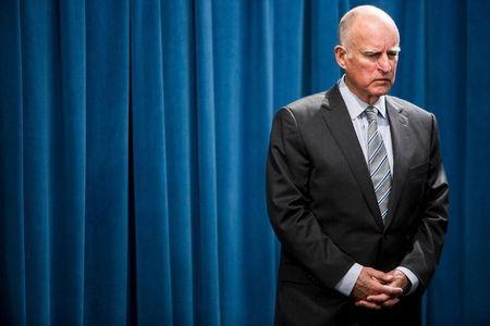 California Governor Jerry Brown waits to speak during a news conference at the State Capitol in Sacramento