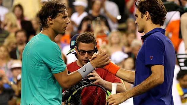 Rafael Nadal of Spain (L) shakes hands with Roger Federer of Switzerland after Nadal won their quarterfinal match during day 9 of the BNP Paribas Open at Indian Wells Tennis Garden on March 14, 2013 (AFP)