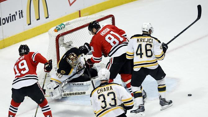 Boston Bruins goalie Tuukka Rask (40) makes a save on a shot by Chicago Blackhawks right wing Marian Hossa (81) during the first period of Game 1 in their NHL Stanley Cup Final hockey series on Wednesday, June 12, 2013, in Chicago. (AP Photo/Charles Rex Arbogast)
