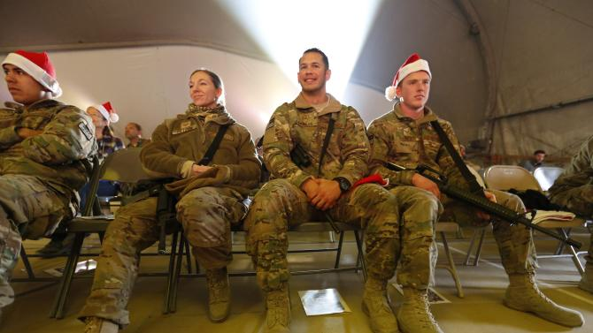 U.S. troops from the Nato-led International Security Assistance Force enjoy Christmas day concert for U.S. military personnel at Bagram Airfield, north of Kabul