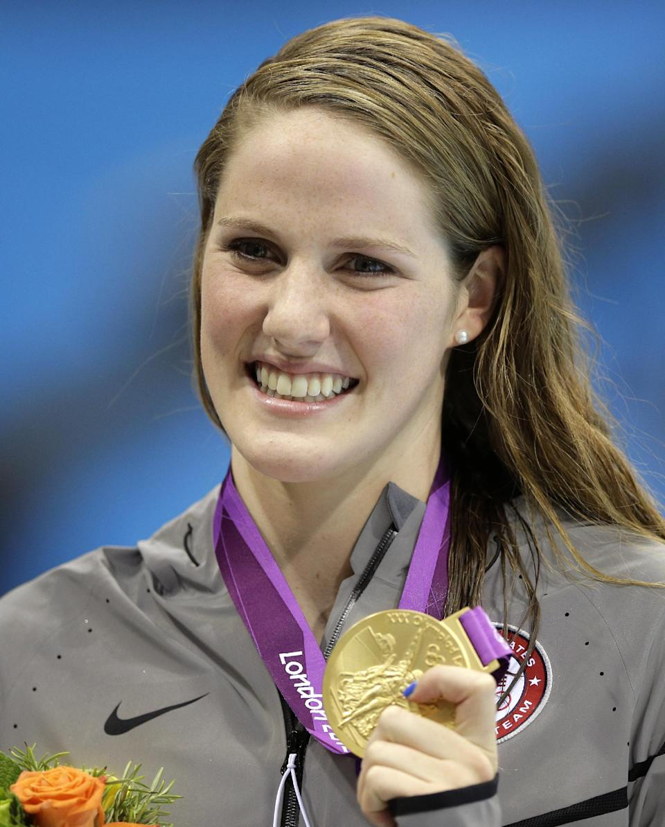 United States' Missy Franklin poses with her gold medal after her win in the women's 200-meter freestyle swimming semifinal at the Aquatics Centre in the Olympic Park during the 2012 Summer Olympics in London, Monday, July 30, 2012. (AP Photo/Matt Slocum)