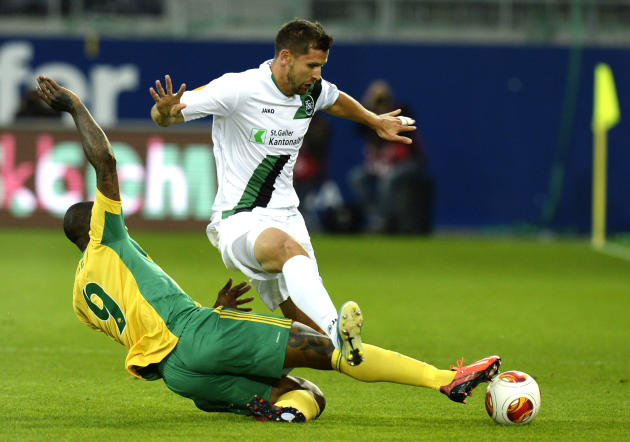 FC St. Gallen's Stephane Besle, right, and Kuban Krasnodar's Djibril Cisse, left, challenge for the ball during their UEFA Europa League Group A  match between Switzerland's FC St. Gallen and Russia's