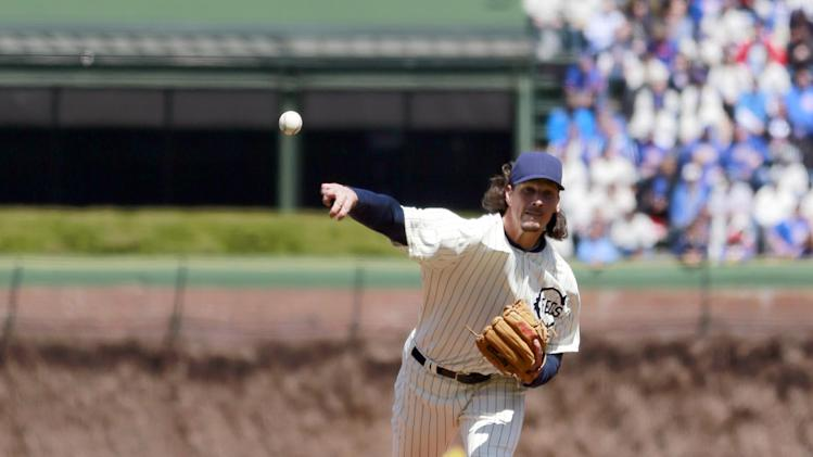 Chicago Cubs starting pitcher Jeff Samardzija delivers a pitch during the first inning at the 100th anniversary of the first baseball game at Wrigley Field against the Arizona Diamondbacks, Wednesday, April 23, 2014, in Chicago