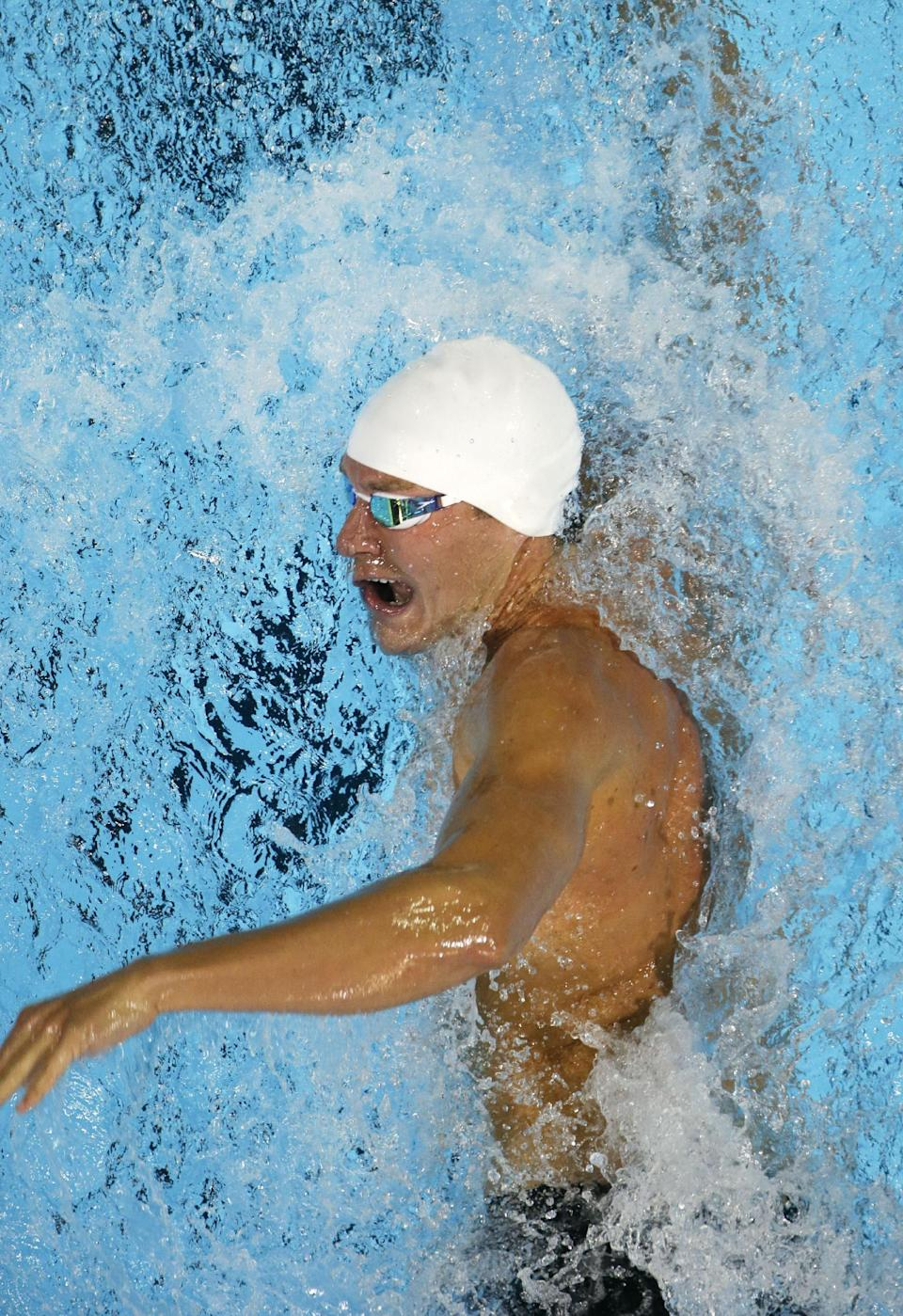 Peter Vanderkaay swims in the men's 200-meter freestyle preliminaries at the U.S. Olympic swimming trials, Tuesday, June 26, 2012, in Omaha, Neb. (AP Photo/Mark Humphrey)