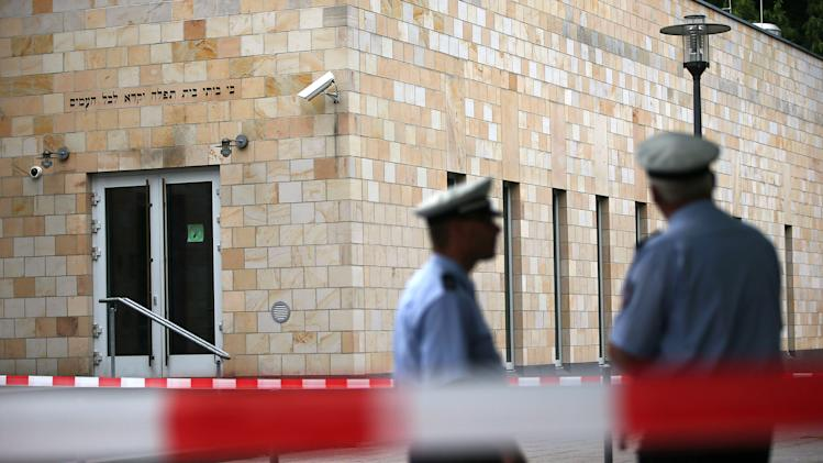 Police guard in front of the synagogue in Wuppertal, Germany, Tuesday July 29, 2014. Police say the synagogue in the western German city of Wuppertal was attacked with petrol bombs overnight, but nobody was injured. (AP Photo/dpa, Oliver Berg)
