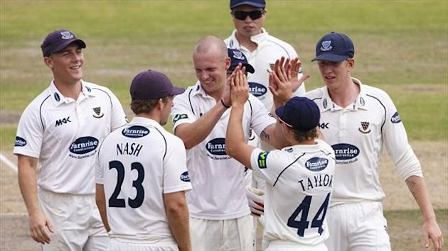 James Taylor, front right, celebrates the dismissal of Ed Cowan