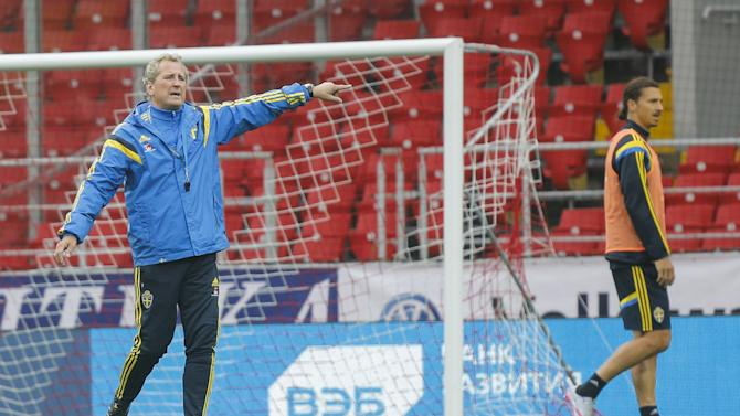 Sweden's national team coach Hamren gestures as Ibrahimovic passes by during a training session  at the Otkrytie Arena stadium in Moscow