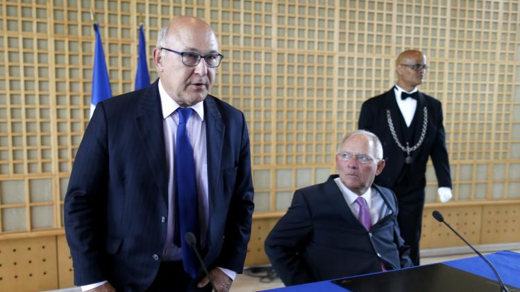 French Finance Minister Michel Sapin and German Finance Minister Wolfgang Schaeuble attend a news conference at the Bercy Finance Ministry in Paris