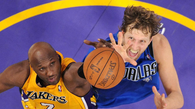 Los Angeles Lakers forward Lamar Odom, left, and Dallas Mavericks forward Dirk Nowitzki of Germany go after a rebound during the second half in Game 2 of a second-round NBA playoff basketball series, Wednesday, May 4, 2011, in Los Angeles. The Mavericks won 93-81. (AP Photo/Mark J. Terrill)