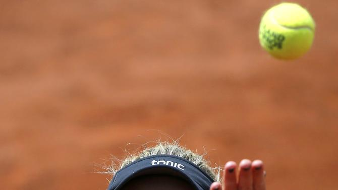 Timea Babos of Hungary serves to Angelique Kerber of Germany during their women's singles match at the French Open tennis tournament at the Roland Garros stadium in Paris