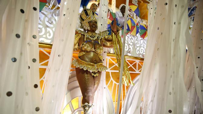 A reveller of Vila Isabel samba school performs during the carnival parade at the Sambadrome in Rio de Janeiro