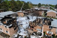 Firefighting foam covers the scene of a crash of an F/A-18D Hornet assigned to Strike Fighter Squadron (VFA) 106 on April 6. Firefighters had been combing through debris to look for three people listed earlier as missing but rescue crews used a checklist of occupants and accounted for all residents of five flattened buildings, Riley said