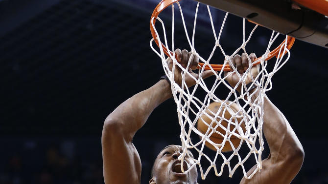 Los Angeles Lakers' Dwight Howard (12) shouts as he misses a dunk against the Phoenix Suns in the first half of an NBA basketball game on Monday, March 18, 2013, in Phoenix. (AP Photo/Ross D. Franklin)