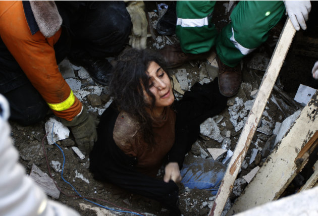 A member of the Abdel Aal family is rescued after his family house collapsed during an Israeli forces strike in the Tufah neighbourhood, Gaza City, Sunday, Nov. 18, 2012. The Israeli military widened
