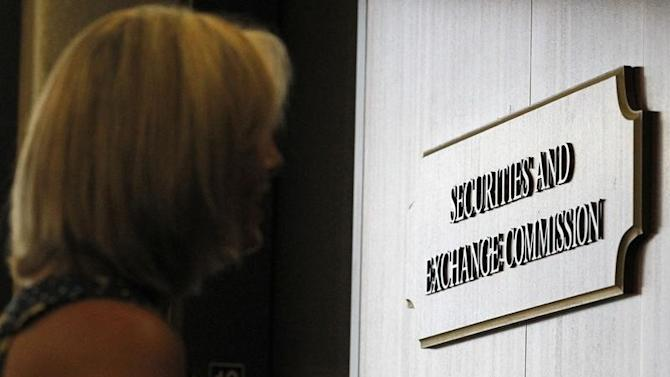 A woman waits for an elevator at the Fort Worth Regional Office of the SEC in Fort Worth
