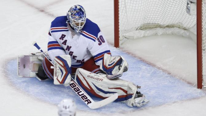 New York Rangers goalie Henrik Lundqvist (30) makes a save against the Boston Bruins during the first period in Game 5 of the Eastern Conference semifinals in the NHL hockey Stanley Cup playoffs in Boston, Saturday, May 25, 2013. (AP Photo/Charles Krupa)