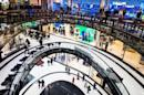 People walk through Mall of Berlin shopping centre during its opening night in Berlin, file