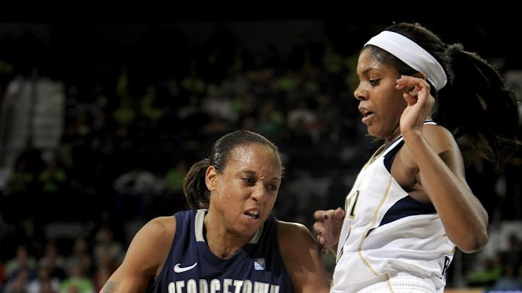 Georgetown guard Andrea White, left, drives against Notre Dame forward Ariel Braker during the first half of an NCAA college basketball game, Tuesday, Jan. 15, 2013, in South Bend, Ind. (AP Photo/Joe Raymond)