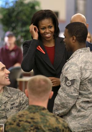 First lady Michelle Obama greets U.S. Air Force personnel in the dining facility at Little Rock Air Force Base in Jacksonville, Ark., Thursday, Feb. 9, 2012. (AP Photo/Danny Johnston)