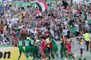 Iraqi players celebrate after scoring a goal during the AFC Asia Cup quarterfinal soccer match between Iran and Iraq in Canberra, Australia, Friday, Jan. 23, 2015. (AP Photo/Andrew Taylor)