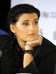 Nelly Furtado Tunda Peluncuran Album