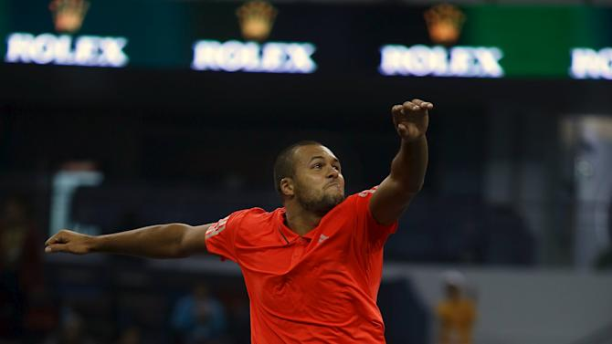 Jo-Wilfried Tsonga of France celebrates winning his men's singles tennis match against Victor Estrella Burgos of Dominican Republic at the Shanghai Masters tennis tournament in Shanghai