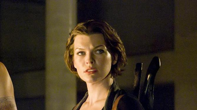 """In this publicity image released by Sony Screen Gems Films, Milla Jovovich is shown in a scene from, """"Resident Evil: Afterlife.""""  Sixteen actors dressed as zombies were injured Tuesday, Oct. 11, 2011, in Toronto when they fell from a platform during filming of """"Resident Evil: Retribution"""" the fifth installment of a franchise based on the popular video game series. Police Constable Tony Vella said the actors had been filming a scene on a high wheeled platform. The platform moved as they were going to another platform, leaving a gap into which the zombies fell. Lead actress Milla Jovovich was not on set at the time of the accident. (AP Photo/Sony Screen Gems, Rafy)"""