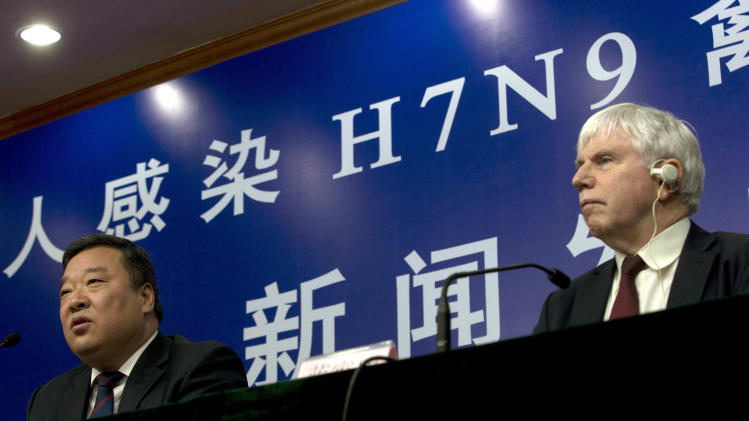 Liang Wannian, head of a Chinese government office in charge of H7N9 bird flu prevention control, left, and Michael O'Leary, head of the World Health Organization's office in China, attend a joint press conference in Beijing, China, Monday, April 8, 2013.  The World Health Organization is talking with the Chinese government about sending international experts to China to help investigate a new bird flu strain that has killed six. Most of the 21 people stricken so far got severely ill. (AP Photo/Ng Han Guan)