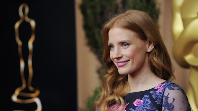 """Jessica Chastain, nominated for best actress in a leading role for """"Zero Dark Thirty,"""" arrives at the 85th Academy Awards Nominees Luncheon at the Beverly Hilton Hotel on Monday, Feb. 4, 2013, in Beverly Hills, Calif. (Photo by Chris Pizzello/Invision/AP)"""