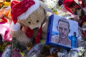 Flowers and messages are left at a memorial rally and…