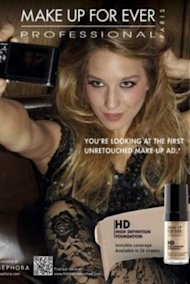 A new ad hitting glossy magazines this week features an unretouched model's flawless skin. 