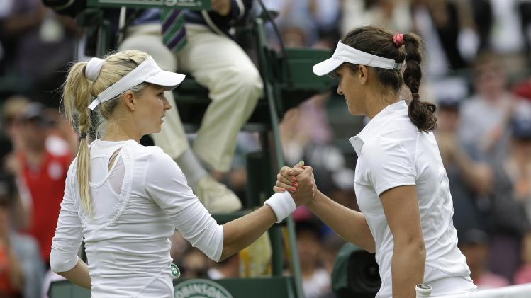Laura Robson of Britain, right, shakes hands with Maria Kirilenko of Russia after defeating her in their Women's first round singles match at the All England Lawn Tennis Championships in Wimbledon, London, Tuesday, June 25, 2013. (AP Photo/Anja Niedringhaus)