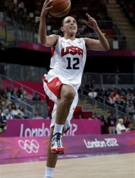 USA&#39;s Diana Taurasi drives to the basket during a quarterfinal women&#39;s basketball game against Canada at the 2012 Summer Olympics, Tuesday, Aug. 7, 2012, in London. (AP Photo/Eric Gay)