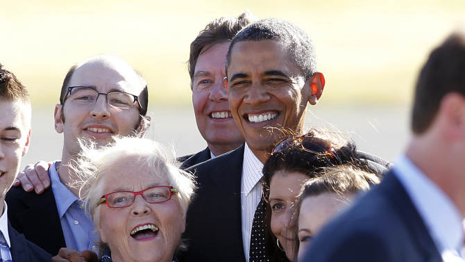 President Barack Obama stands for a group photo with supporters who greeted him on his arrival, Tuesday, July 24, 2012, in Seattle. Obama is scheduled to attend a pair of campaign fund-raisers in the area. (AP Photo/Elaine Thompson)
